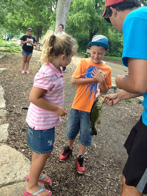 Young Kids Looking at a Fish