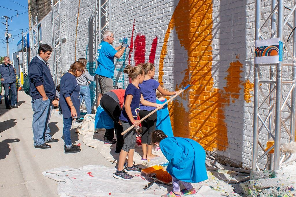 Community members work together to complete mural during Better Block.