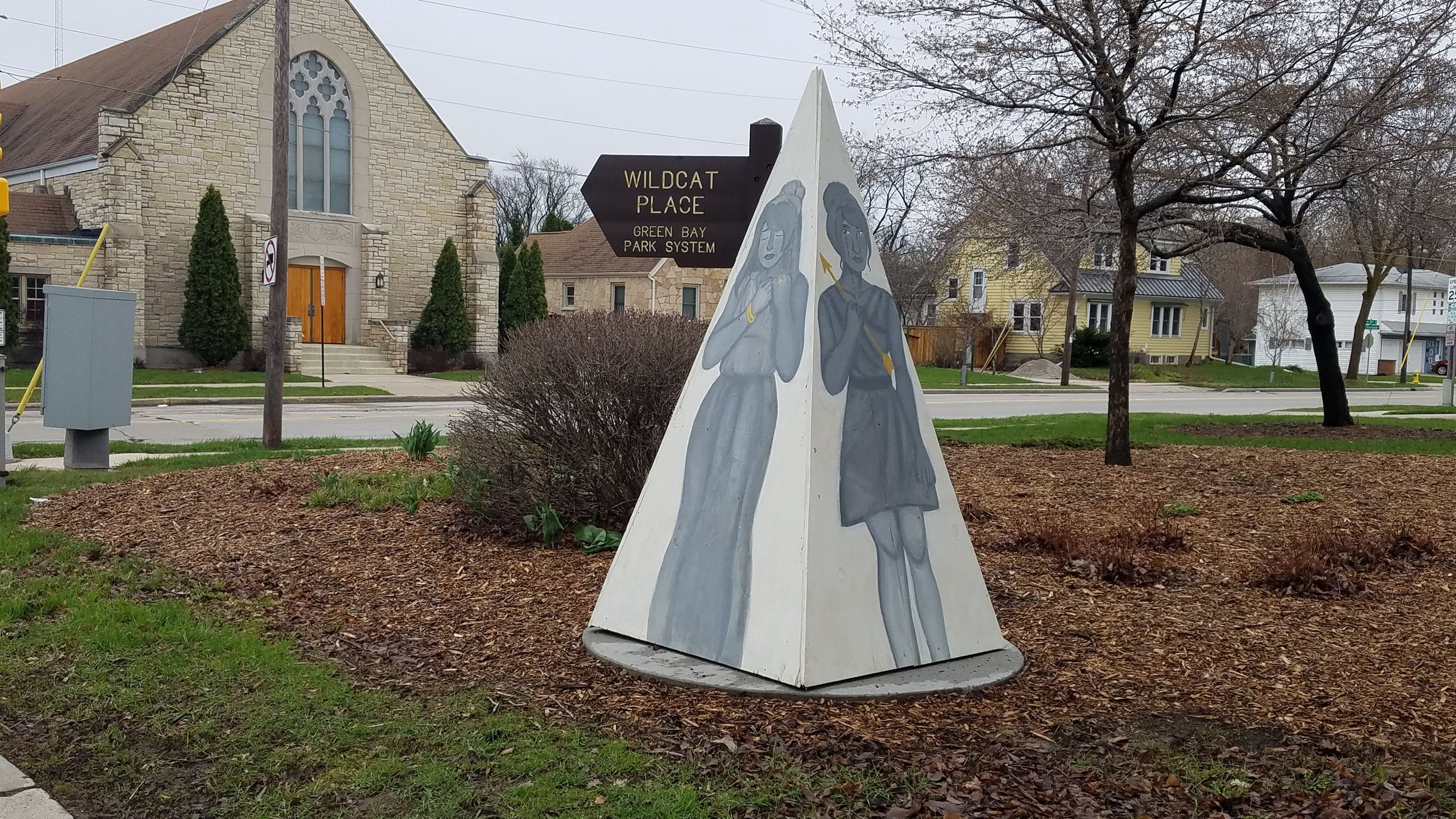 Painted pyramid sculpture depicting Greek goddesses by Kira Dampier