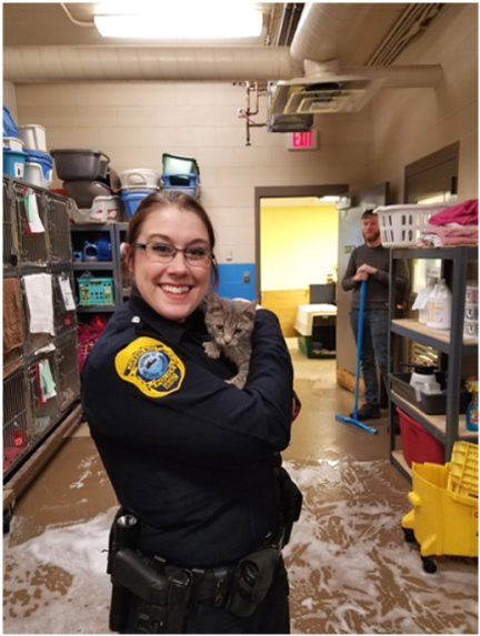 Animal Control officer holding a cat